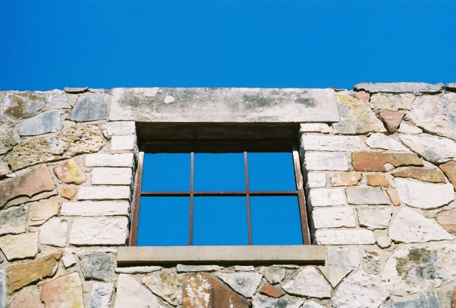 vacant window in an old rock building