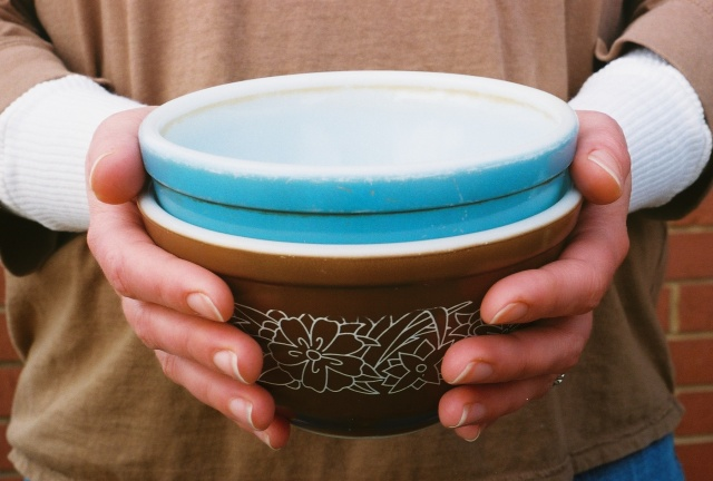 giving - portrait of Melissa holding bowls, 35mm film